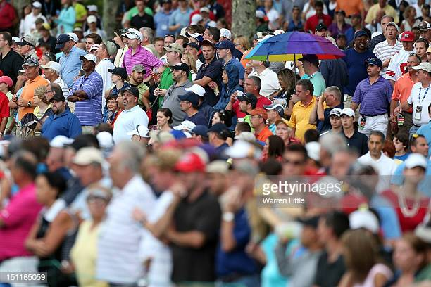 Spectators watch around the 18th green during the third round of the Deutsche Bank Championship at TPC Boston on September 2, 2012 in Norton,...