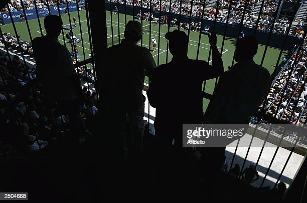 Spectators watch as Ashley Harkelyroad plays Vera Douchevina of Russia during the US Open on August 25 2003 at the USTA National Tennis Center...