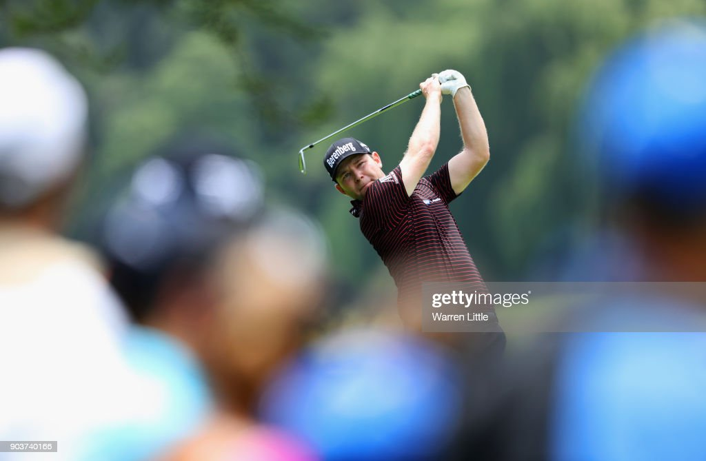 Spectators watch as Branden Grace of South Africa plays his second shot on the 4th hole during Day One of The BMW South African Open Championship at Glendower Golf Club on January 11, 2018 in Johannesburg, South Africa.