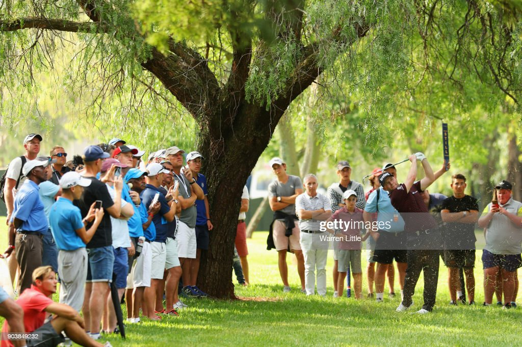 Spectators watch as Branden Grace of South Africa plays his second shot on the 18th hole during Day One of The BMW South African Open Championship at Glendower Golf Club on January 11, 2018 in Johannesburg, South Africa.