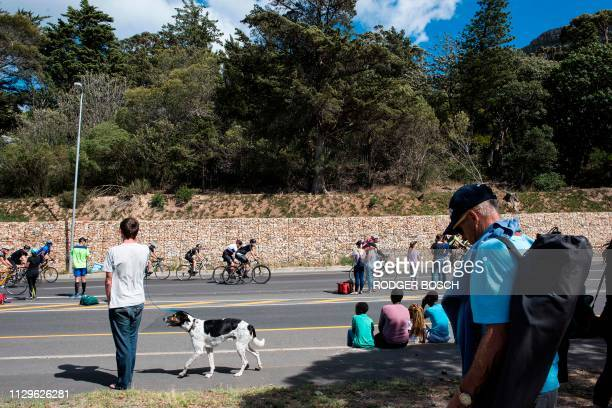 Spectators watch as cyclists ride up the final climb Suikerbossie near Hout Bay during the Cape Town Cycle Tour on March 10 in Cape Town This cycle...