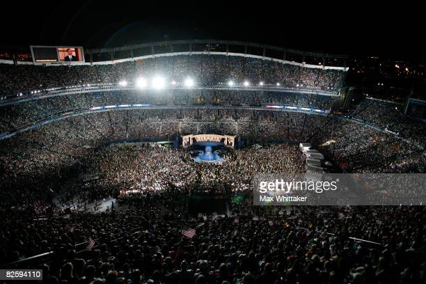 Spectators watch as Democratic US Presidential nominee Sen Barack Obama speaks on day four of the Democratic National Convention at Invesco Field at...