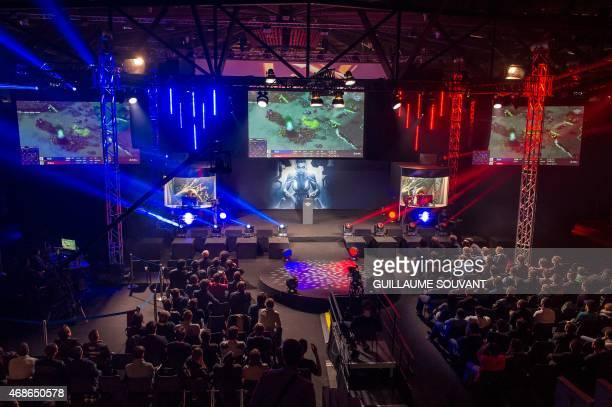 Spectators watch as gamers compete on April 4 2015 in a round of the world tournament of the game StarCraft II during the 16th edition of the Gamers...