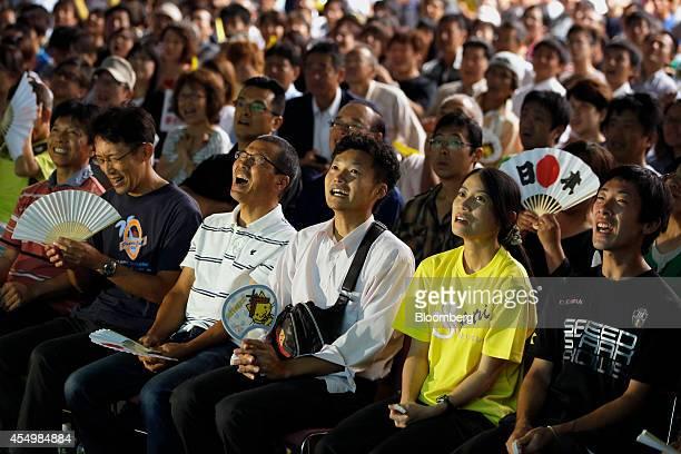 Spectators watch as Japan's Kei Nishikori plays against Croatia's Marin Cilic in the US Open men's singles final match at a public viewing venue in...