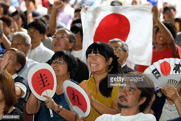Spectators watch as Japan's Kei Nishikori plays against Croatia's Marin Cilic in the US Open Tennis Championships men's singles final match at a...
