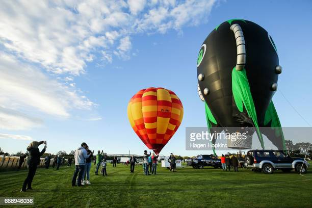 Spectators watch as John Snodgrass in 'Wildfire' and Alain Bard in 'Alien Rocket' prepare to fly during the Meander over Martinborough event at the...