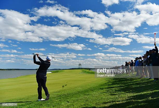 Spectators watch as Matthew Fitzpatrick of England plays a shot on the 15th hole during the final round on day four of the Nordea Masters at Bro Hof...