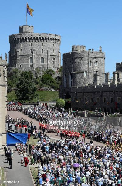 Spectators watch as members of The Life Guards attend the Most Noble Order of the Garter Ceremony at St George's Chapel Windsor Castle in Windsor...