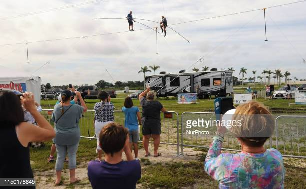 Spectators watch as Nik Wallenda and his sister Lijana Wallenda practice on the high wire at Nathan Benderson Park on June 15 2019 in Sarasota...