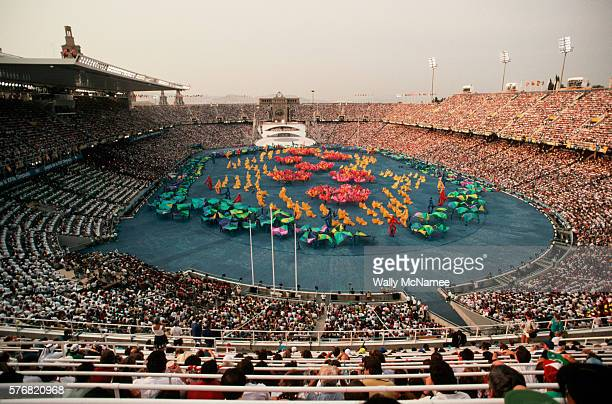Spectators watch as performers in brightly colored costumes perform during the opening ceremonies for the 1992 Summer Olympic Games in Barcelona...