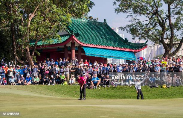 Spectators watch as SSP Chawrasia of India plays a shot during the round four of UBS Hong Kong Open 2017 at The Hong Kong Golf Club on November 26...