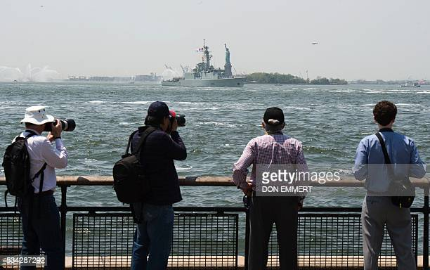 Spectators watch as the HMCS Athabaskan , of the Royal Canadian Navy, makes its way through New York Harbor and up the Hudson River May 25, 2016 in...