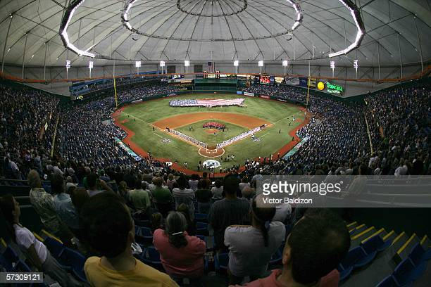 Spectators watch as the national anthem is sung before the Tampa Bay Devil Rays season opener against the Baltimore Orioles on April 10 2006 at...