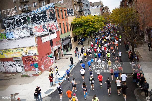 Spectators watch as the runners of the 40th ING New York City Marathon pass through the Williamsburg section of the borough of Brooklyn on November 1...