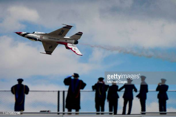 Spectators watch as the Unites States Air Force Thunderbirds perform at the United States Air Force Academy graduation ceremony on May 30 2019 in...