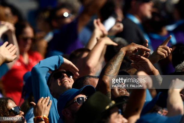 Spectators watch as the Virgin Galactic SpaceShipTwo space plane Unity and mothership separate, as they fly way above Spaceport America, near Truth...