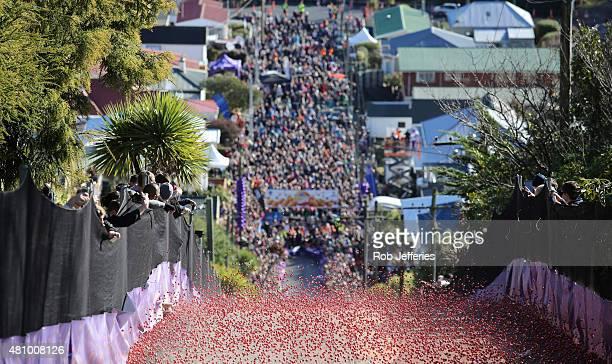 Spectators watch as thousands of Jaffa candies race down Baldwin Street on July 17 2015 in Dunedin New Zealand The residential street is the steepest...