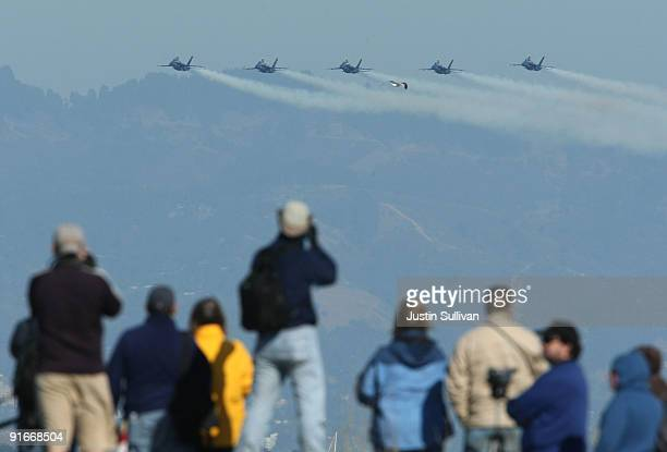 Spectators watch as US Navy Blue Angels F/A18 Hornets practice their performance ahead of the Fleet Week air show October 9 2009 in San Francisco...