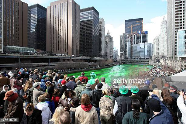 Spectators watch as workers spread an orange powder to dye the Chicago River green before the start of St Patricks Day Parade March 17 2007 in in...