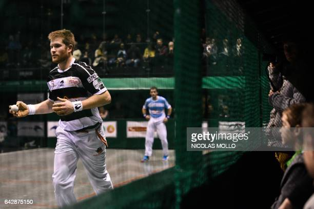 Spectators watch Baptiste Ducassou play a shot during the final of the French championship of professional individual barehanded Basque Pelota...
