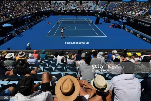 Spectators watch Belarus' Aryna Sabalenka play against Russia's Anna Kalinskaya during their women's singles match on day one of the Australian Open...