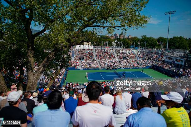 Spectators watch Belgium's David Goffin vs Russia's Andrey Rublev in their Qualifying Men's Singles match at the 2017 US Open Tennis Tournament on...
