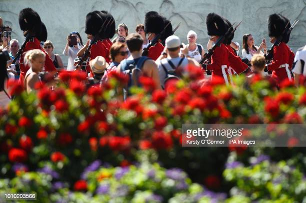 Spectators watch Changing the Guard at Buckingham Palace in London as another blast of hot weather is set to hit parts of the UK