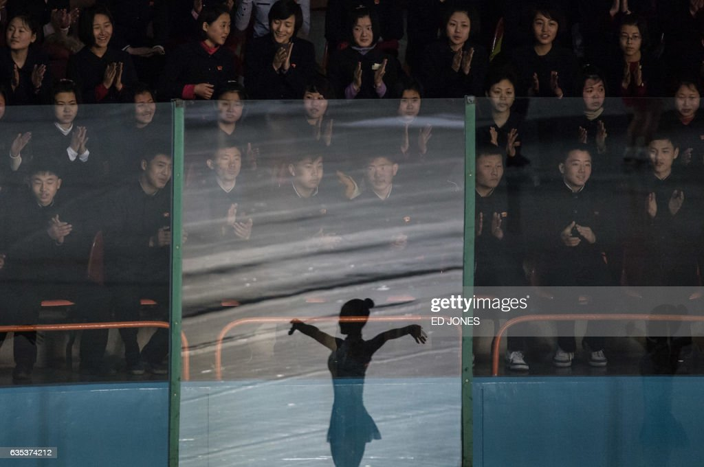 TOPSHOT - Spectators watch figure skaters perform at the Paektusan Prize International Figure Skating Festival in Pyongyang on February 15, 2017. The Paektusan Prize International Figure Skating Festival is held every year to celebrate Kim Jong-Il, the leader who oversaw the North's first nuclear tests. /