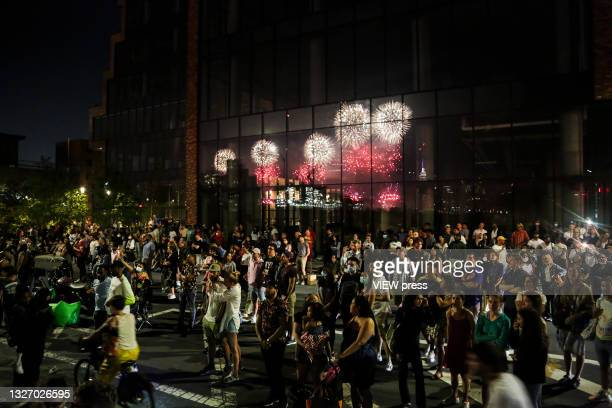 Spectators watch fireworks explode during Macy's 45th annual July 4th fireworks show overlooking the Manhattan skyline in Brooklyn on July 4, 2021 in...