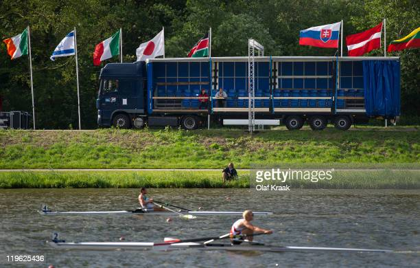 Spectators watch from a moving 'grandstand' truck alongside the track during Day Four of the FISA World Rowing Under 23 Championships 2011 on the...