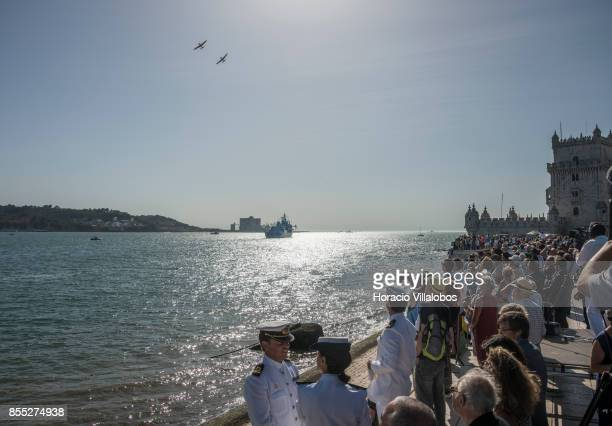 Spectators watch from Belem Tower aerobatics over Tagus River during the commemoration of the 100th anniversary of Portuguese Naval Aviation on...