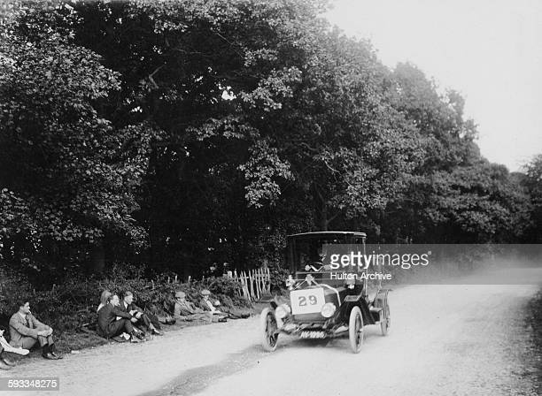 Spectators watch from beside the course as JW Taylor drives the Flanders Automobile Model 15/20hp up the hill during the Leicester Automobile Club...