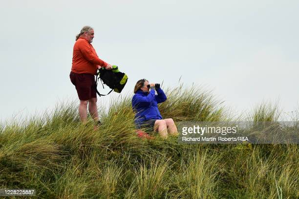 Spectators watch from outside the course during Round 2 of Matchplay on Day Three of The Women's Amateur Championship at The West Lancashire Golf...