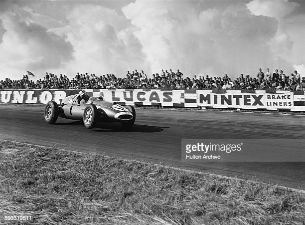 Spectators watch from Paddock Hill Bend as Roy Salvadori of Great Britain drives the High Efficiency Motors T53 CooperClimax during the V Silver City...