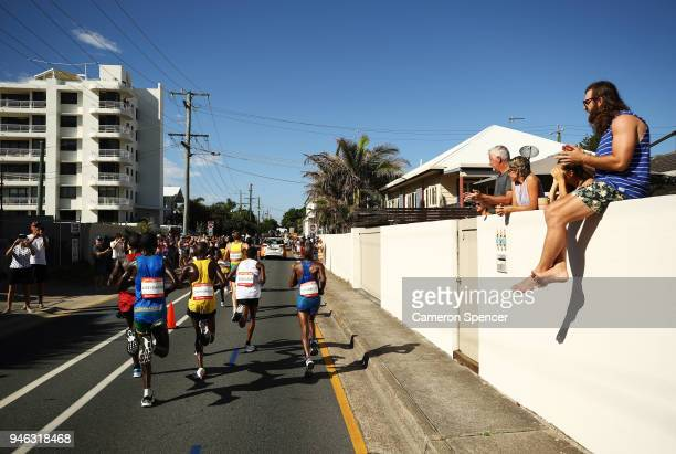 Spectators watch from roadside during the Men's marathon on day 11 of the Gold Coast 2018 Commonwealth Games at Southport Broadwater Parklands on...