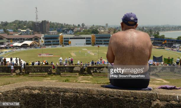 Spectators watch from the fort overlooking the grounf during the 1st Test match between Sri Lanka and England at the Galle International Stadium...