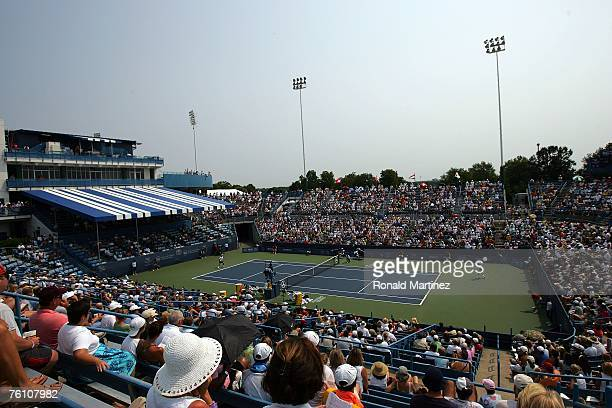 Spectators watch from the grandstand during play between Fernando Gonzalez of Chile and Juan Carlos Ferrero of Spain at the Western Southern...
