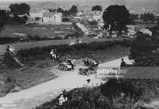 Spectators watch from the roadside as the T GibbonsBrooks driving a 20/28 hp Darracq races up the hill during the first Cardiff Motor Club Open hill...