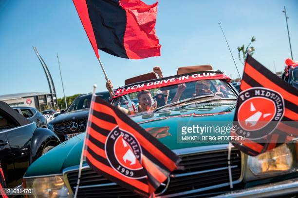 Spectators watch in their cars the drive-in football match between FC Midtjylland and AC Horsens at the MCH Arena in Herning, Denmark, on June 1,...