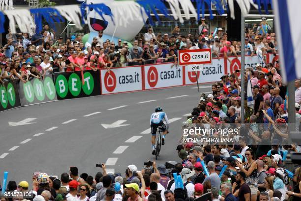 Spectators watch Italy's rider of UAE Emirates team Valerio conti riding during the 1st stage of the 101st Giro d'Italia Tour of Italy on May 4 a 97...