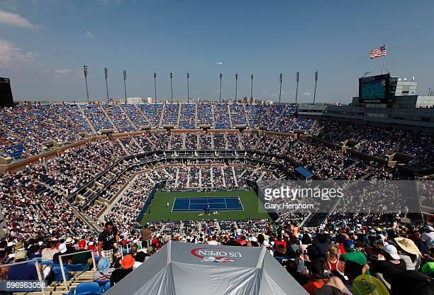 Spectators watch Kei Nishikori of Japan play Novak Djokovic of Serbia in their semifinal match at the US Open tennis championship in New York...
