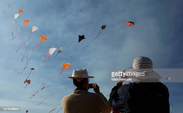 Spectators watch kites in the sky at the annual Festival of the Winds kite flying festival on Bondi Beach on September 9 2012 in Sydney Australia The...