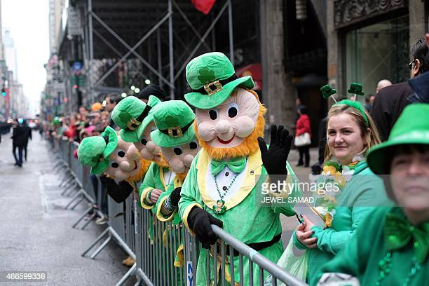 Spectators watch marchers walking past during the St Patrick's Day parade in New York on March 17 2015 AFP PHOTO/JEWEL SAMAD