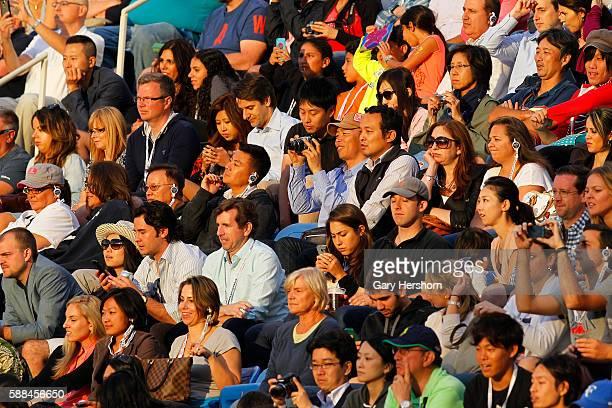 Spectators watch Marin Cilic of Croatia play Kei Nishikori of Japan in the men's final at the US Open tennis championship in New York September 8 2014