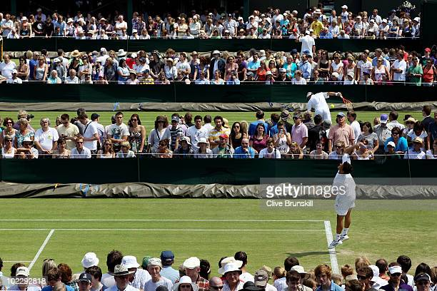 Spectators watch matches on Day Two of the Wimbledon Lawn Tennis Championships at the All England Lawn Tennis and Croquet Club on June 22 2010 in...