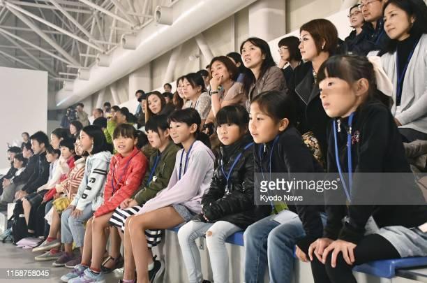 Spectators watch Olympic figure skating champion Alina Zagitova train on an ice rink in the Japanese city of Niigata on July 30 2019 ==Kyodo