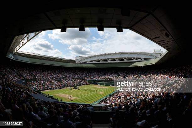 Spectators watch on a full capacity Centre Court as Serbia's Novak Djokovic returns to Italy's Matteo Berrettini during their men's singles final...