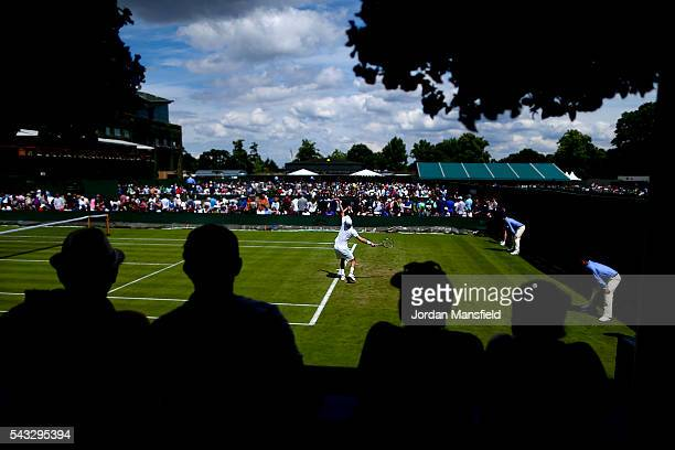 Spectators watch on as Kevin Anderson of South Africa serves during his first round match against Denis Istomin of Uzbekistan during day one of the...