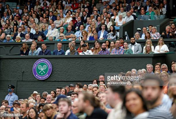 Spectators watch on Centre Court as Poland's Hubert Hurkacz plays against Russia's Daniil Medvedev during their men's singles fourth round match on...
