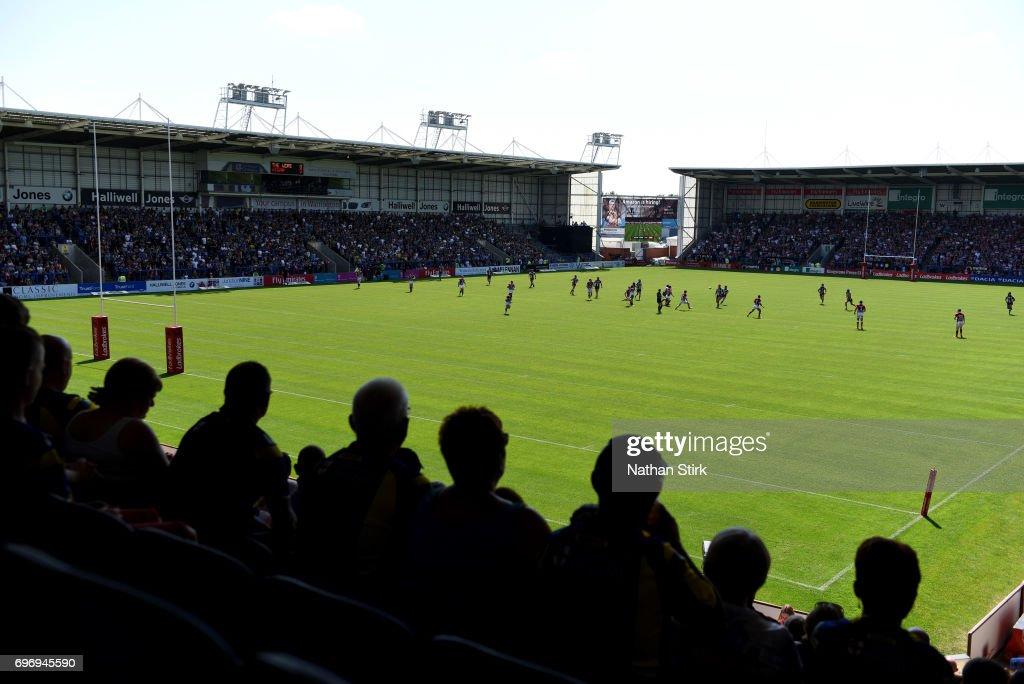Spectators watch on during the Ladbrokes Challenge Cup Quarter-Final match between Warrington Wolves and Wigan Warriors at Halliwell Jones Stadium on June 17, 2017 in Warrington, England.